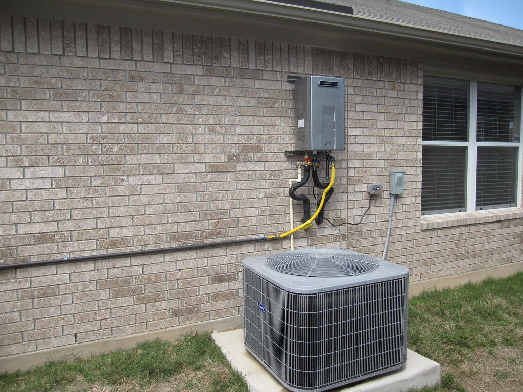 A tankless hot water heater